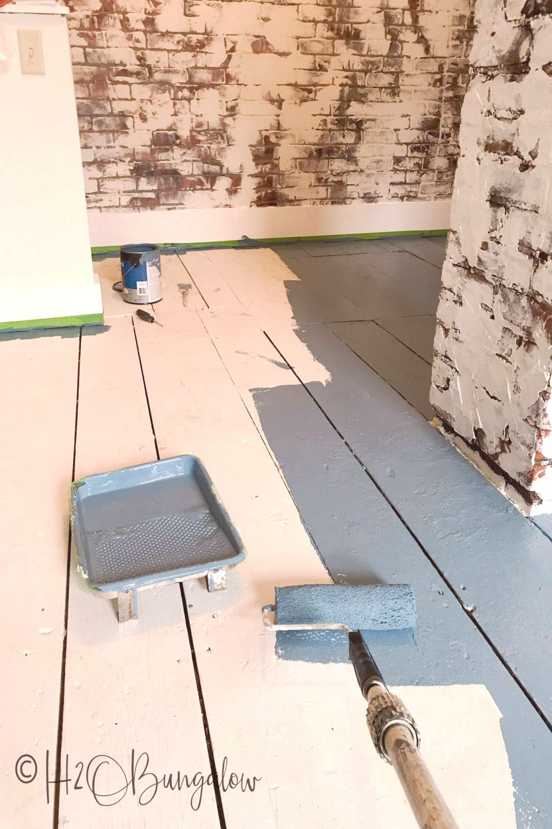 DIY tutorial on how to paint wood floors with detailed instructions to prepare wood floors for pain