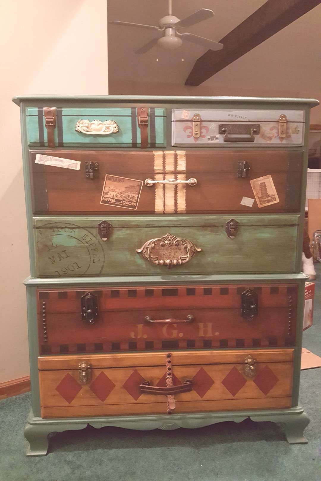Dresser I painted for Judes, travel themed bedroom. Suitcase luggage dresser drawers.