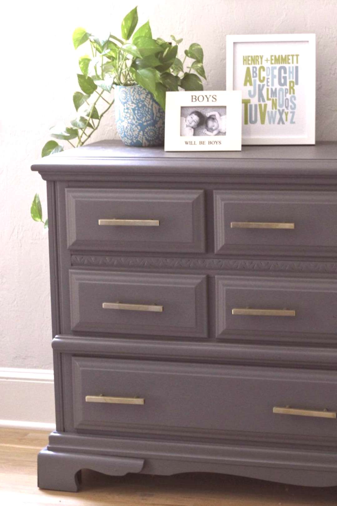 Gray dresser painted with gray chalk paint and new brass hardware |