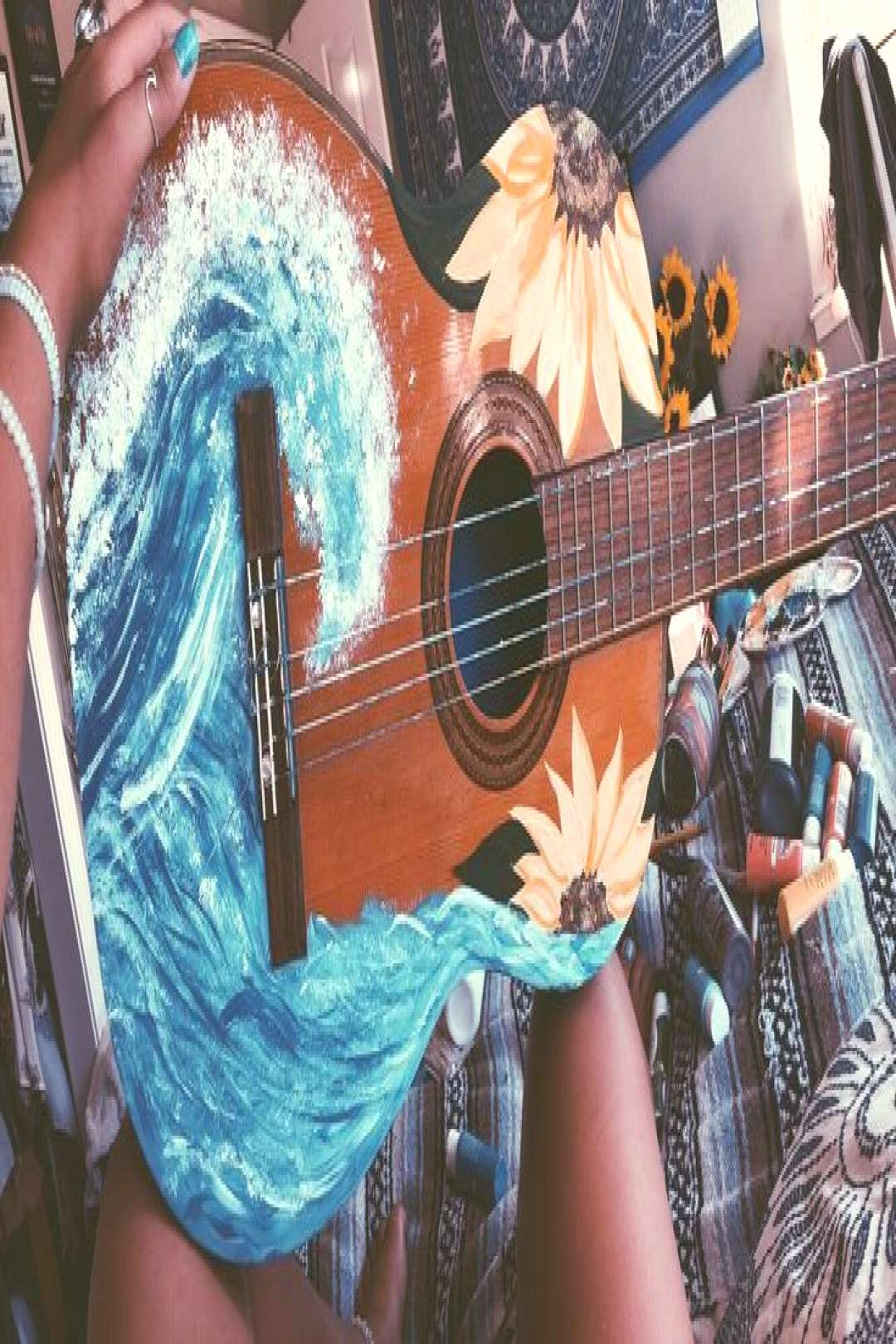 Painted guitar waves and sunflowers