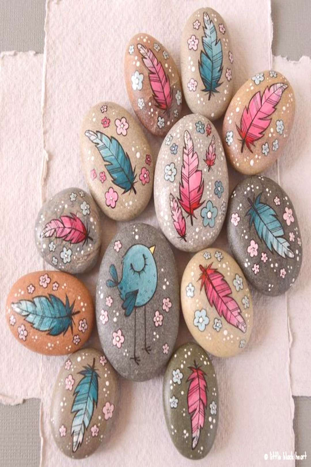 Painted pebbles -feather pair,